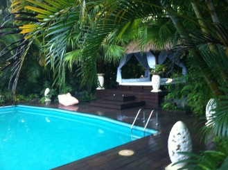 "The five star ""Retreat"" cottage includes this beautifully landscaped deck, private swimming pool, and Balinese gazebo."