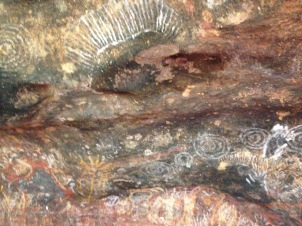 A section of Aboriginal rock paintings on the Kuniya Walk at Uluru.
