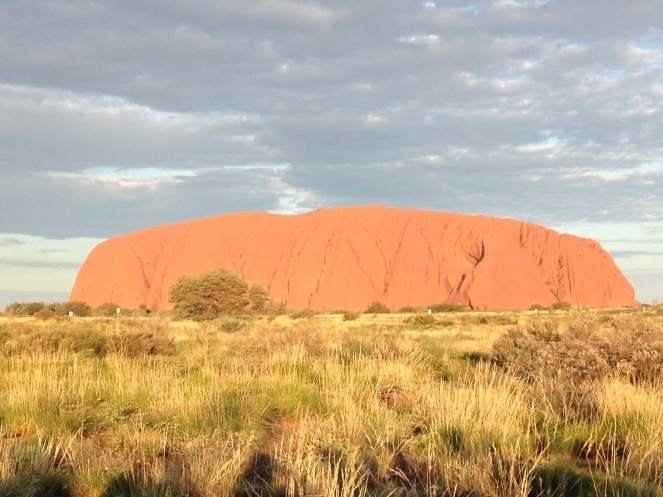 The changing colors of Uluru as the sun goes down from the sunset viewing area.