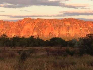 Sun setting on the Bungle Bungles. The light glows with changing oranges, pinks, and lavenders that is other worldly.