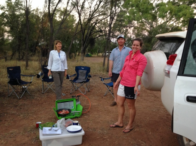 Gayl, Joel, and Victoria setting up camp and preparing a delicious meal.