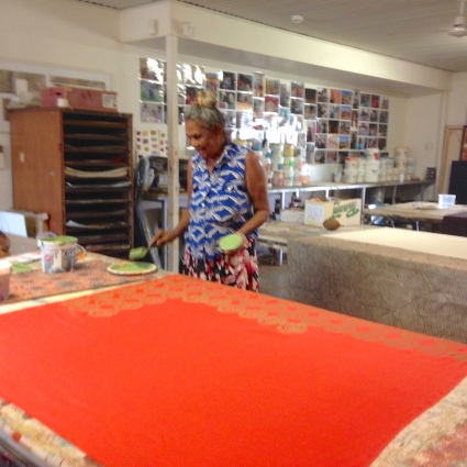 Artist Peggy Griffiths designing and hand printing a length of linen fabric. Cotton and silk fabric are also used.