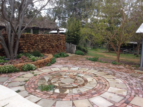 I visited in early spring before flowers really pop, but the amount of sweat equity is apparent. Hand-built rock walls, fencing, and garden paths showcase years of work.