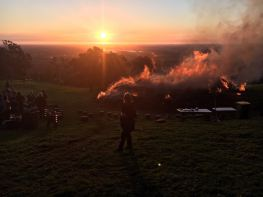 High on a hill, a raging bonfire at sunset, good food and drinks, great company: Doesn't get much better than this.